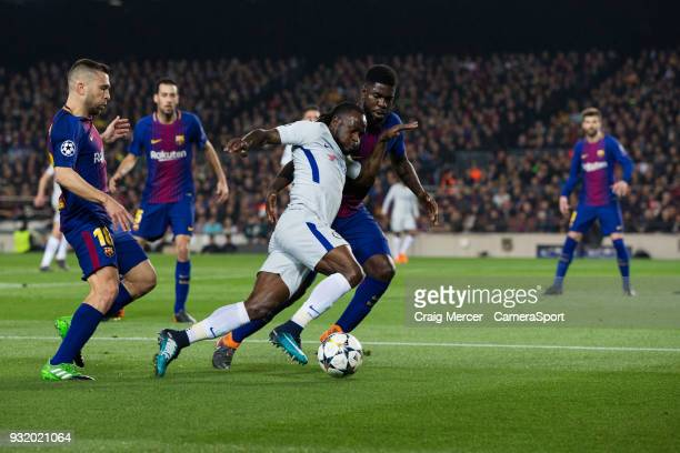 Chelsea's Victor Moses battles for possession with Barcelonas Samuel Umtiti during the UEFA Champions League Round of 16 Second Leg match FC...