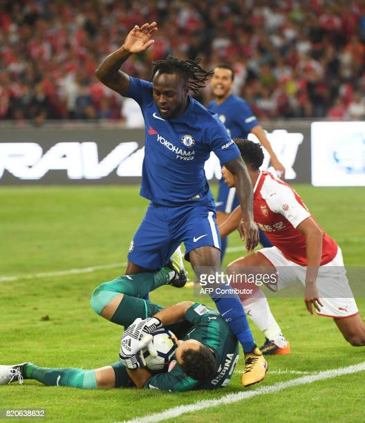 Chelsea's Victor Moses challenges Arsenal's goalkeeper David Ospina during their friendly football match at Beijing's National Stadium known as the...