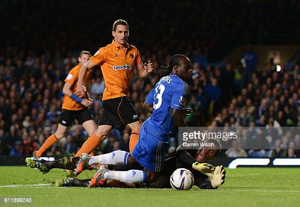 Chelsea's Victor Moses goes down under the challenge from Wolverhampton Wanderers' Dorus De Vries