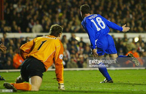 Chelsea's Wayne Bridge runs past Arsenal goal keeper Jens Lehmann after scoring the winning goal during their Champions League quarterfinal second...