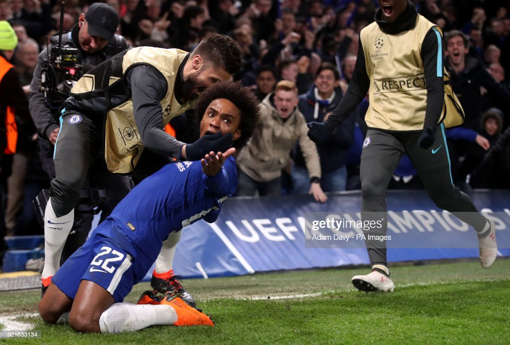 Chelsea's Willian celebrates scoring his side's first goal of the game with team mate Olivier Giroud during the UEFA Champions League round of sixteen, first leg match at Stamford Bridge, London.
