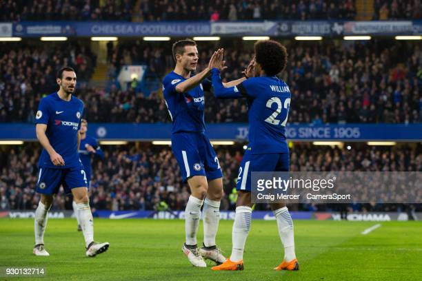 Chelsea's Willian celebrates scoring the opening goal with team mate Cesar Azpilicueta during the Premier League match between Chelsea and Crystal...