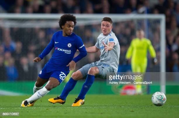 Chelsea's Willian holds off the challenge from Everton's James McCarthy during the Carabao Cup Fourth Round match between Chelsea and Everton at...