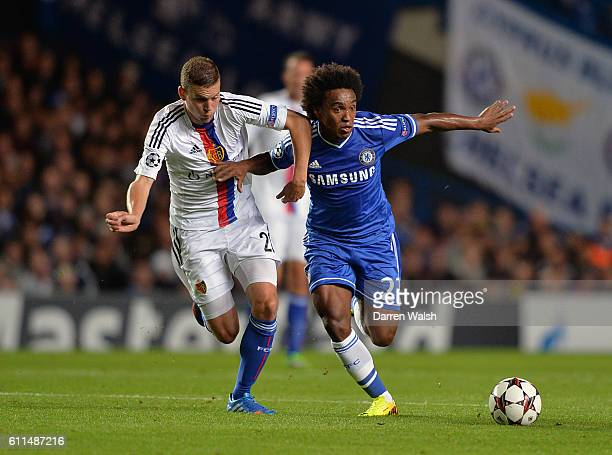 Chelsea's Willian in action with FC Basel's Fabian Frei