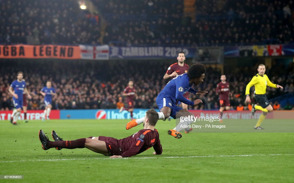 Chelsea's Willian jumps over a challenge from Barcelona's Gerard Pique during the UEFA Champions League round of sixteen, first leg match at Stamford Bridge, London.