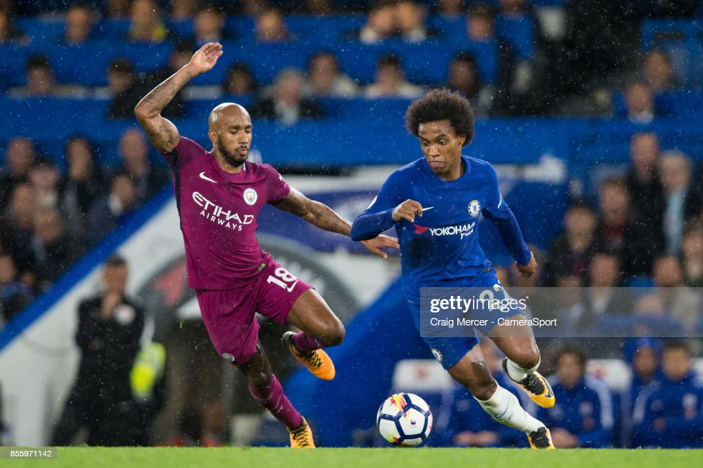 Chelsea's Willian vies for possession with Manchester City's Fabian Delph during the Premier League match between Chelsea and Manchester City at Stamford Bridge on September 30, 2017 in London, England.