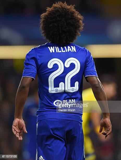 Chelsea's Willian wearing a shirt with the Plan International logo on the back