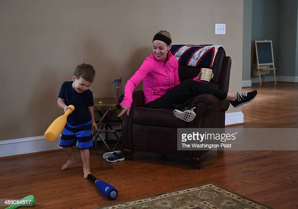Chelsey Desmond right the wife of Washington Nationals short stop Ian Desmond plays with her son Grayson at home before a game on Thursday April 22...