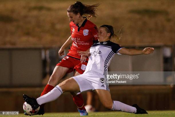 Chelsie Dawber of Adelaide United and Alexandra Gummer of Melbourne Victory contest the ball during the round 14 WLeague match between Adelaide...