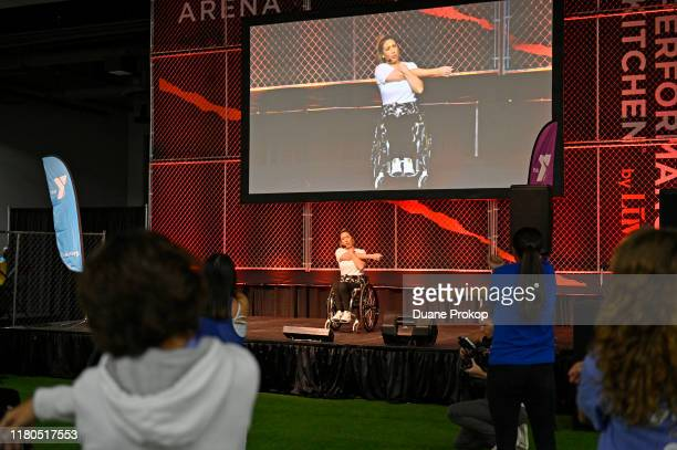 Chelsie Hill leads a Dance Class at the Fitness Arena presented by Performance Kitchen by LUVO during the first day of Wellness Your Way Festival at...