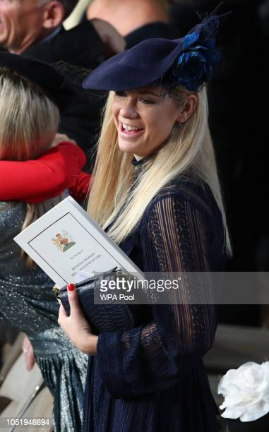 Chelsy Davy takes her seat ahead of the wedding of Princess Eugenie of York and Mr Jack Brooksbank at St George's Chapel on October 12 2018 in...