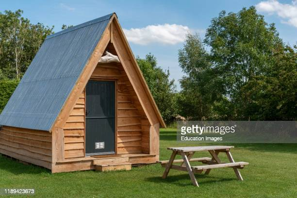 Cheltenham, Gloucetsershire, England, Wooden camping pods in the Cotswolds region of Gloucestershire.