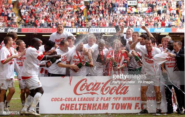 Cheltenham players celebrate with champagne after beating Grimsby Town in the Coca-Cola League Two play-off final at the Millennium Stadium, Cardiff.