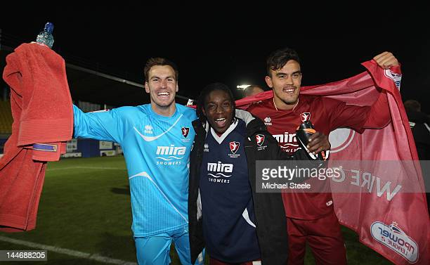 Cheltenham Town goalscorers Jermaine McGlashan and Marlon Pack alongside goalkeeper Scott Brown celebrate their 21 victory during the npower League...