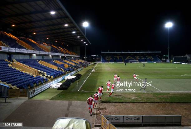 Cheltenham Town players enter the pitch prior to the Sky Bet League Two match between Mansfield Town and Cheltenham Town at One Call Stadium on March...
