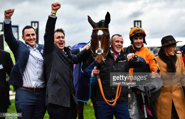 Cheltenham United Kingdom 10 March 2020 Jockey Aidan Coleman orange silks with Put The Kettle On and winning Connections including trainer Henry De...