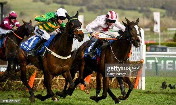 Cheltenham United Kingdom 11 March 2020 Dame De Compagnie with Barry Geraghty up left on their way to winning the Coral Cup Handicap Hurdle ahead of...