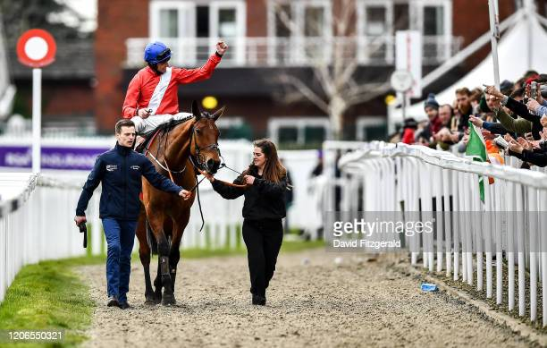 Cheltenham United Kingdom 11 March 2020 Jockey Davy Russell on Envoi Allen celebrates winning the Ballymore Novices' Hurdle on Day Two of the...