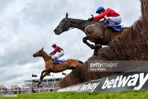 Cheltenham United Kingdom 11 March 2020 Minella Indo with Rachael Blackmore up left who came in second jumping the last ahead of Allaho with Paul...