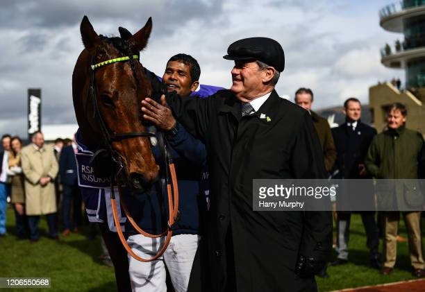 Cheltenham United Kingdom 11 March 2020 Owner JP McManus with Champ after winning the RSA Insurance Novices' Chase on Day Two of the Cheltenham...