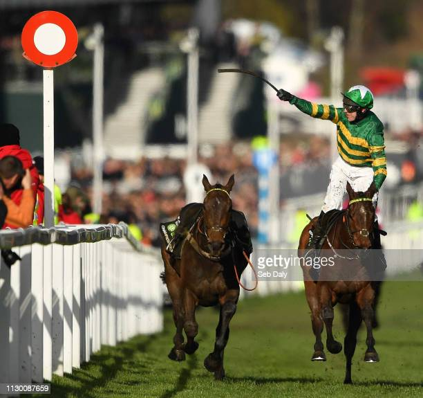 Cheltenham United Kingdom 12 March 2019 Jockey Mark Walsh celebrates as he crosses the line to win the Unibet Champion Hurdle Challenge Trophy on...