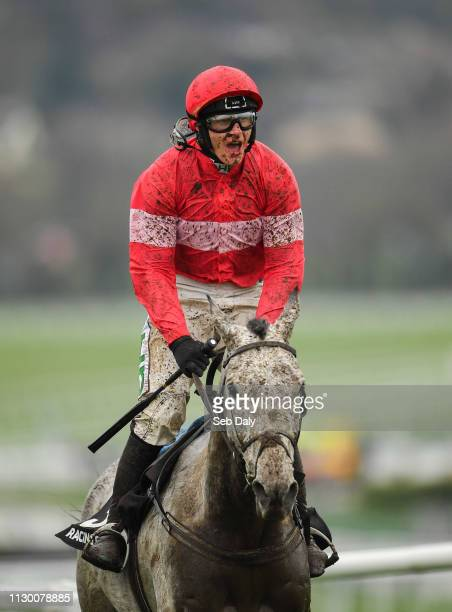 Cheltenham United Kingdom 12 March 2019 Jockey Paul Townend celebrates as he crosses the line to win the Racing Post Arkle Challenge Trophy Novices'...