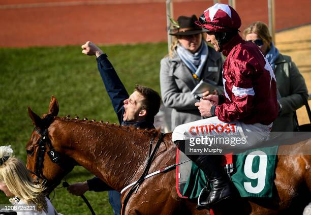 Cheltenham United Kingdom 12 March 2020 Jockey Davy Russel on Samcro come into the parade after winning the Marsh Novices' Chase on Day Three of the...