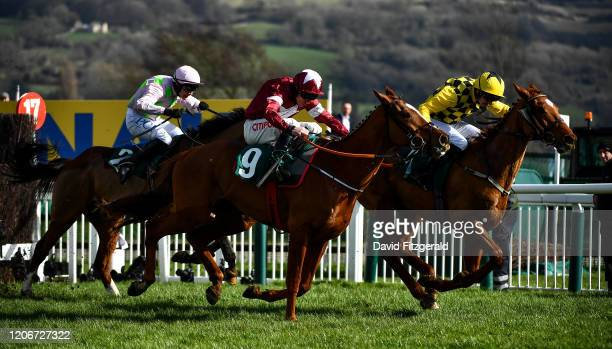 Cheltenham United Kingdom 12 March 2020 Melon with Patrick Mullins up right leads the eventual winner Samcro with Davy Russell up centre and Faugheen...