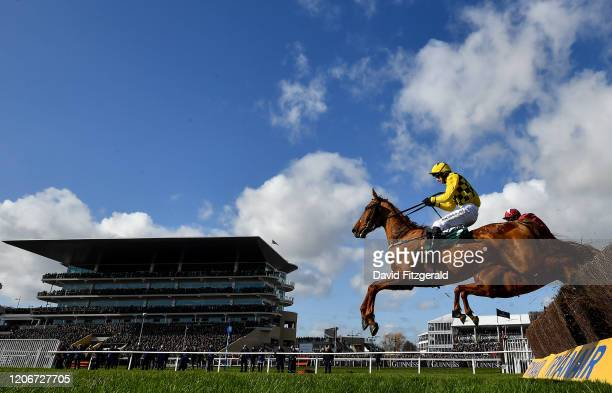 Cheltenham United Kingdom 12 March 2020 Melon with Patrick Mullins up leads the eventual winner Samcro with Davy Russell up behind as they jump the...