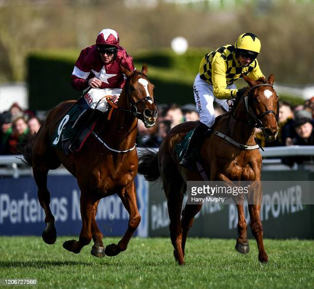 Cheltenham United Kingdom 12 March 2020 Samcro with Davy Russell up race ahead of Melon with Partick Mullins up to win the Marsh Novices' Chase on...