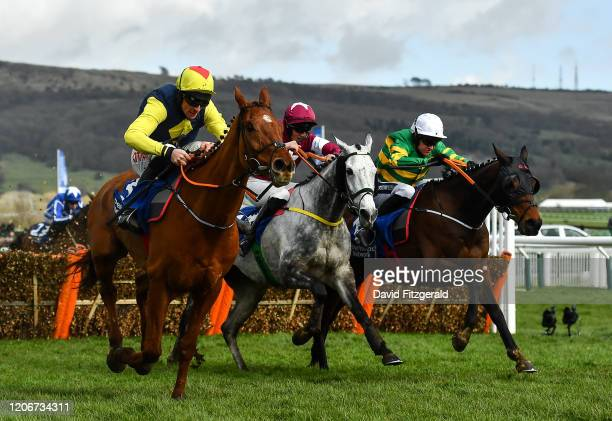 Cheltenham United Kingdom 12 March 2020 The runnerup The Storyteller with Davy Russell up left leads Tout Est Permis with Eoin Walsh up who finished...