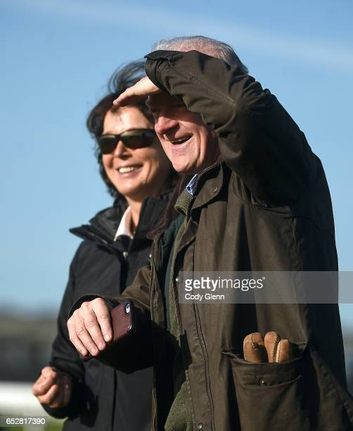 Cheltenham United Kingdom 13 March 2017 Trainer Willie Mullins and wife Jackie Mullins on the gallops prior to the start of the Cheltenham Racing...