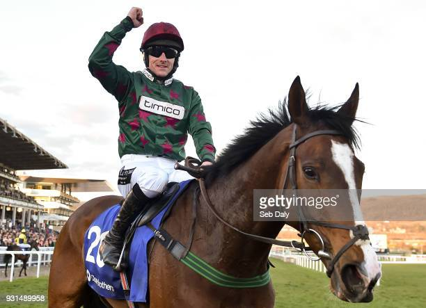 Cheltenham , United Kingdom - 13 March 2018; Jockey Brian Hughes celebrates after winning The Close Brothers Novices' Handicap Chase on Mister...