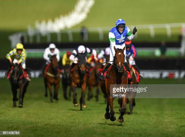 Cheltenham United Kingdom 13 March 2018 Jockey Lizzie Kelly celebrates after winning the Ultima Handicap Steeple Chase on Coo Star Sivola during Day...