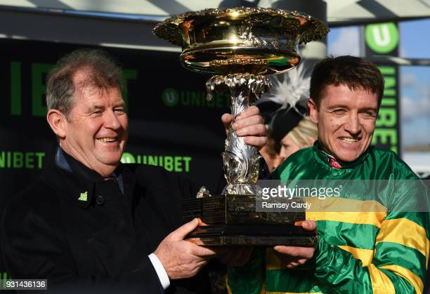 Cheltenham United Kingdom 13 March 2018 Owner JP McManus and jockey Barry Geraghty after winning the UniBet Champion Hurdle Challenge Trophy with...