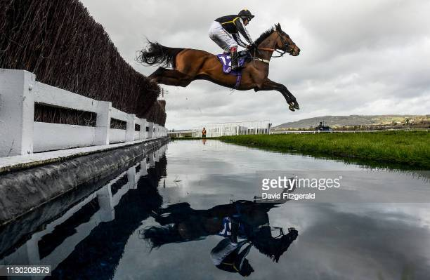 Cheltenham United Kingdom 13 March 2019 Drinks Interval with Richard Johnson up clears the water jump during the RSA Insurance Novices' Chase on Day...