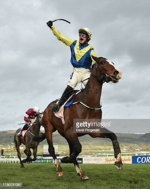 Cheltenham United Kingdom 13 March 2019 JJ Slevin celebrates as he crosses the finish line onboard Band Of Outlaws to win the Boodles Juvenile...
