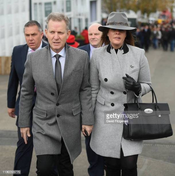 Cheltenham United Kingdom 13 March 2019 TV host Jeremy Kyle arrives with girlfriend Vicky Burton prior to racing on Day Two of the Cheltenham Racing...