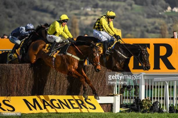 Cheltenham United Kingdom 13 March 2020 Al Boum Photo with Paul Townend up jump the last ahead of Lostintranslation with Robbie Power up to win the...