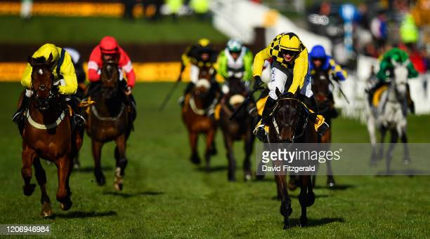 Cheltenham United Kingdom 13 March 2020 Al Boum Photo with Paul Townend up right passes the post to win the Magners Cheltenham Gold Cup Chase ahead...