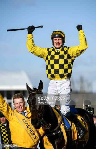 Cheltenham United Kingdom 13 March 2020 Jockey Paul Townend celebrates after winning the Magners Cheltenham Gold Cup Chase on Al Boum Photo during...