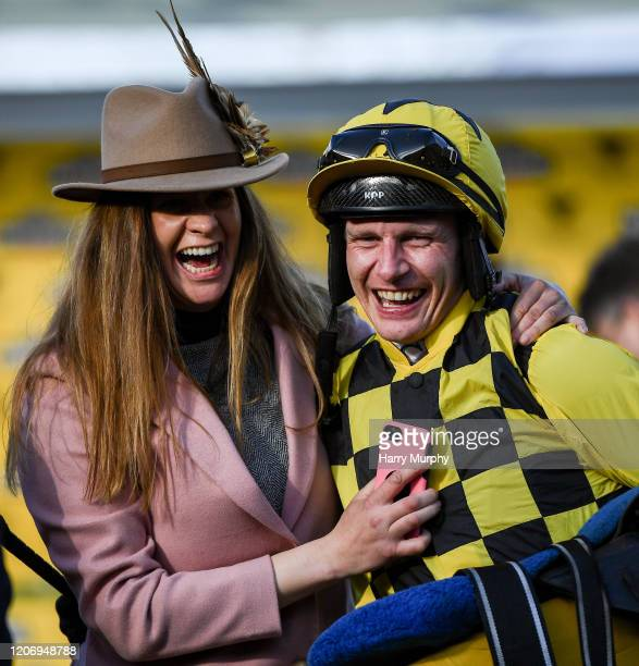 Cheltenham United Kingdom 13 March 2020 Jockey Paul Townend celebrates with winning connection Rachel Robins after winning the Magners Cheltenham...