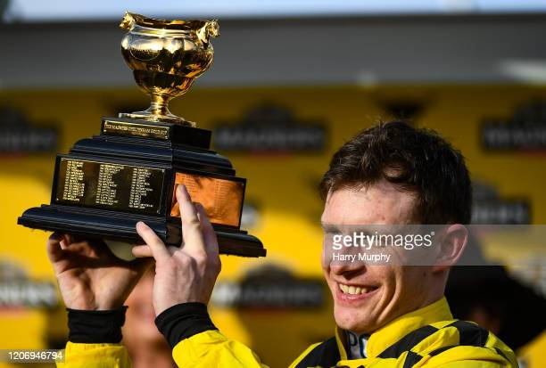 Cheltenham United Kingdom 13 March 2020 Jockey Paul Townend with the cup after winning the Magners Cheltenham Gold Cup Chase on Al Boum Photo during...
