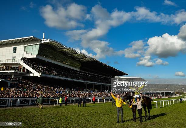Cheltenham United Kingdom 13 March 2020 Paul Townend on Al Boum Photo celebrates with Stable Hand Paul Roche left and winning connections after the...