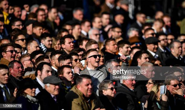Cheltenham United Kingdom 13 March 2020 Racegoers react during the Albert Bartlett Novices' Hurdle on Day Four of the Cheltenham Racing Festival at...