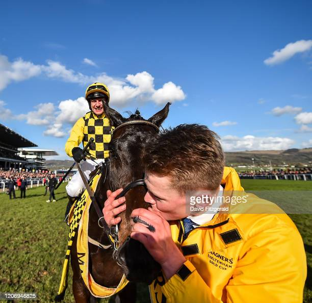 Cheltenham United Kingdom 13 March 2020 Stable Hand Paul Roche kisses Al Boum Photo after Paul Townend rode him to victory in the Magners Cheltenham...