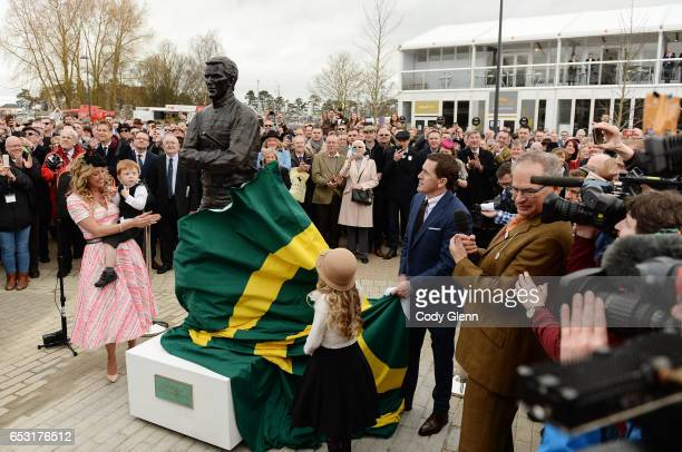 Cheltenham United Kingdom 14 March 2017 Former jockey AP McCoy unveils his new statue alongside wife Chanelle daughter Eve and son Archie Peter prior...
