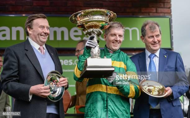 Cheltenham United Kingdom 14 March 2017 Trainer Nicky Henderson left jockey Noel Fehily centre and owner JP McManus after winning the Stan James...