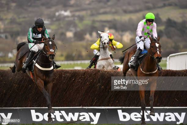 Cheltenham United Kingdom 14 March 2018 Altior left with Nico de Boinville up jumps the last alongside Min with Paul Townend up on their way to...