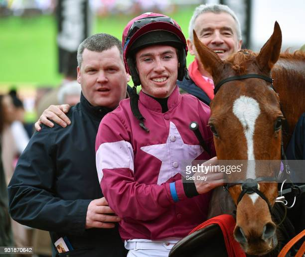 Cheltenham United Kingdom 14 March 2018 Jockey Jack Kennedy centre with trainer Gordon Elliott left and owner Michael O'Leary after winning the...